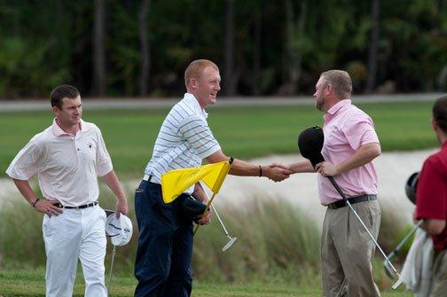 Cody Ednress and Josh Immordino shake hands at the 18th hole
